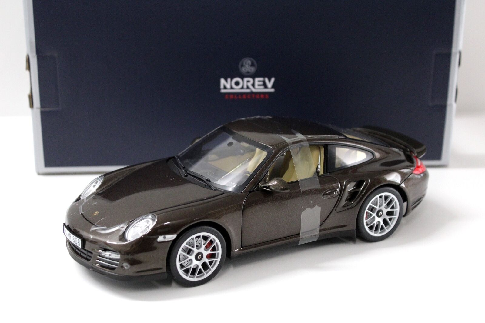 1 18 Norev Porsche 911 (997) Turbo 2010 marron Met. New chez Premium-modelcars