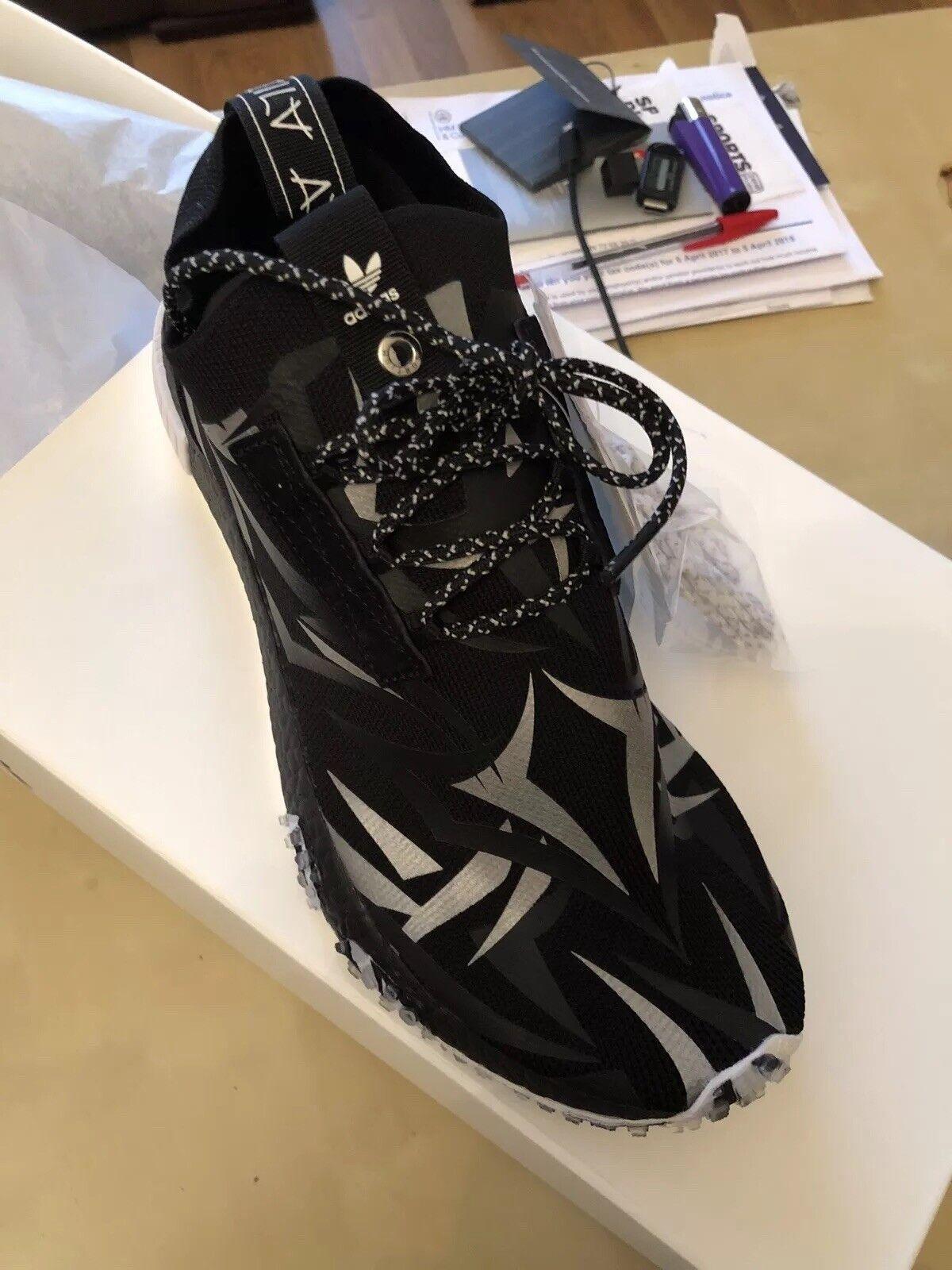 a continuación al por menor  Adidas Consortium X JUICE NMD Racer UK9