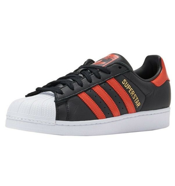 adidas superstar black white orange