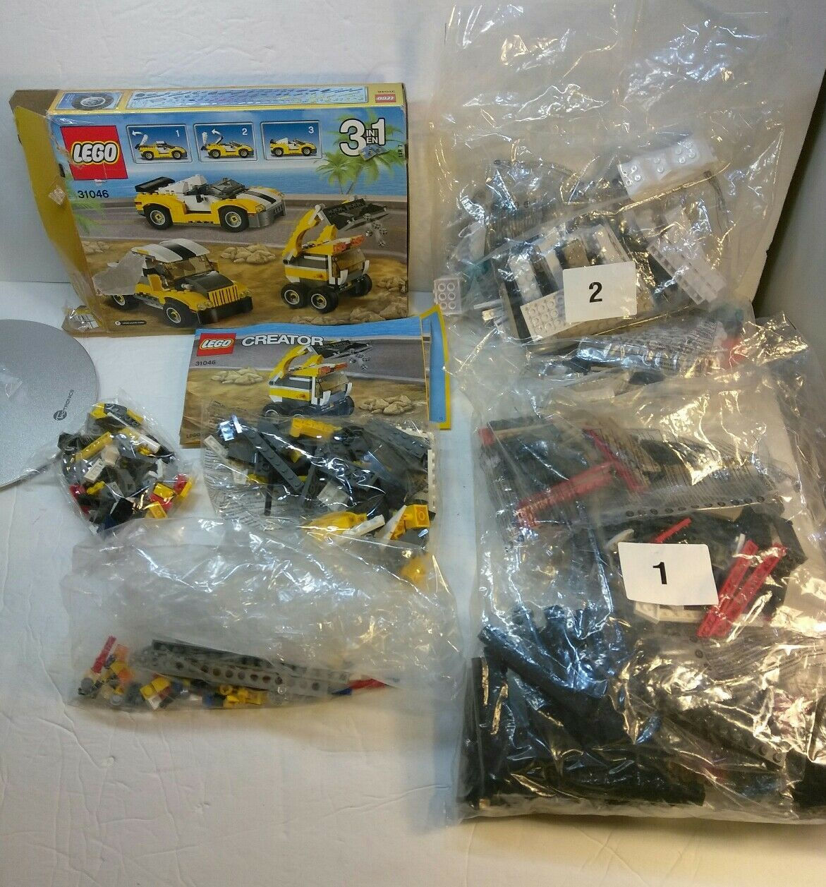 Lego 31046 Creator Fast Car  and two bags of Legos 5559 and 5564.