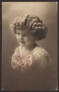 Pretty-Little-Girl-with-Enormous-Bow-on-her-Dress-1913-Tinted-Photogravure-Card