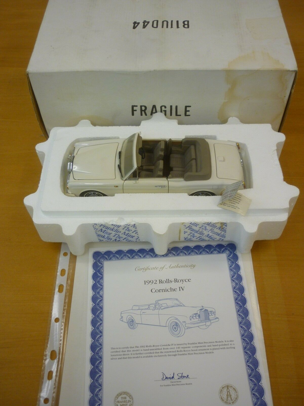 A Franklin mint scale model of a 1992 Rolls Royce Corniche, paperwork   boxed