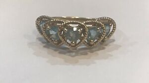 """10K SOLID YELLOW GOLD """"FIVE HEARTS"""" BLUE TOPAZ RING  - SIZE 6.5"""