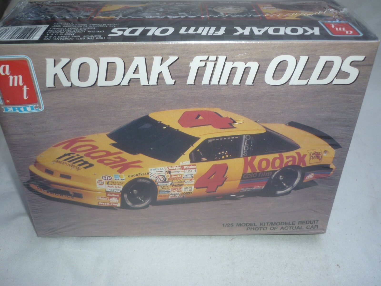 AMT   ERTL un-opened plastic kit of a Kodak Films Oldsmobile, Factory sealed