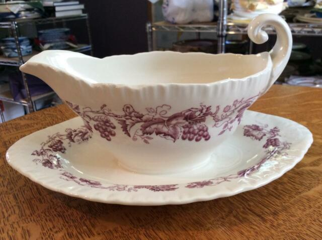 Wedgwood Old Vine shell edge creamware gravy boat with attached underplate