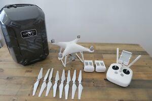 DJI-Phantom-4-Camera-Drone-White-With-Traveling-backpack