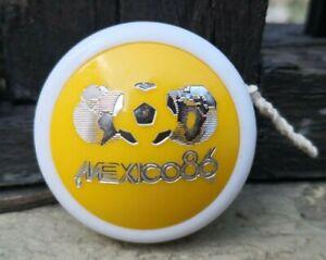 VTG-1980-039-s-MEXICAN-YO-YO-YELLOW-PLASTIC-TOY-FIFA-SOCCER-WORLD-CUP-MEXICO-1986