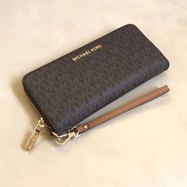 db89e2a49a7742 NWT Michael Kors Brown PVC MK Signature Jet Set Zip Around Wristlet Wallet