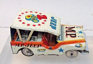 """circa 1950 M.P. MILITARY POLICE JEEP tin litho 3.5"""" friction car JAPAN by S.K."""