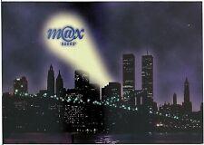 Max Racks Spotlight Above Twin Towers at Night Modern Advertising Rack Postcard