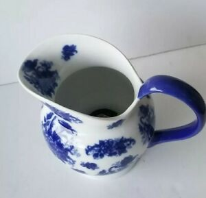 Blue-and-white-ceramic-pitcher-with-lotus-like-flowers-blue-handle-large