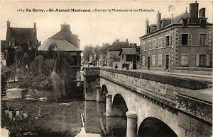 CPA St-AMAND-MONTROND - Pont sur la Marmande et Rue Nationale (634833)