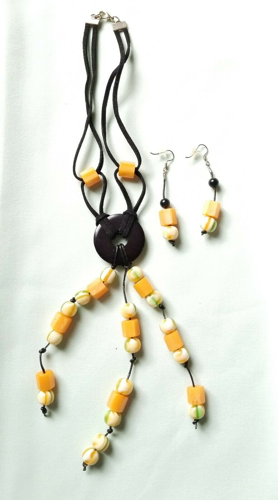 Handcrafted necklace and earrings, proper packed in a jewelry gift box.
