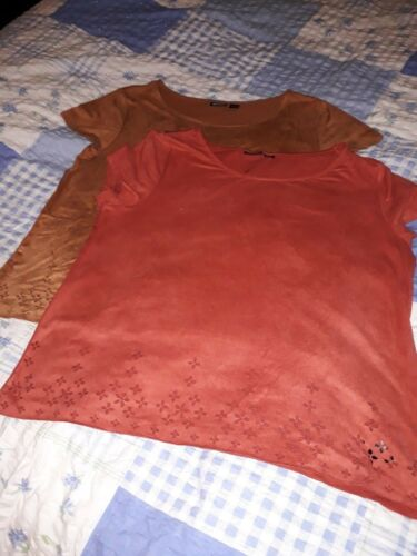 size small 10-12 rust or beige with cut out design at hem suede feel tops