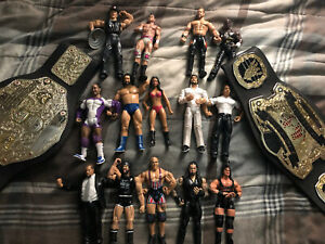Lot-of-14-2000-039-s-WWE-Wrestling-Action-Figures-And-Two-Belts-Jakks-Pacific-TNA