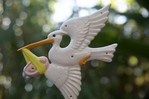 Adorable Vintage Pottery Nursery Stork Delivering Baby Wall Hanging