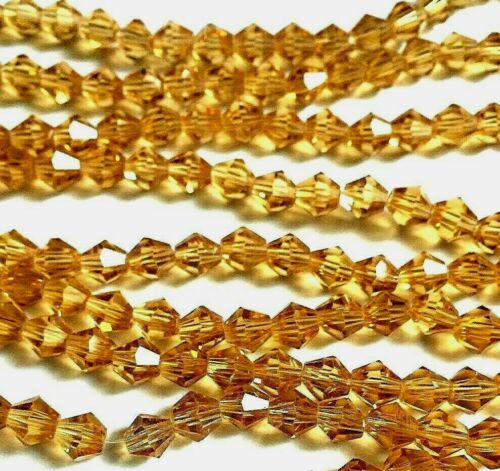 Size 6mm. 100 x Golden Coloured Faceted Glass Bicone Shaped Beads
