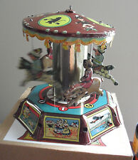 COOL Modern Tin Windup Carousel with Man on Horses and Pigs with Box