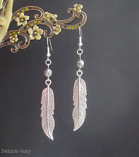 Large Silver Feather Charm and Starry Bead Dangly Earrings - Ethnic Boho