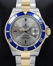 Rolex Submariner 16613 2Tone 18k Y Gold/SS Serti Blue Sapphires Diamonds Papers