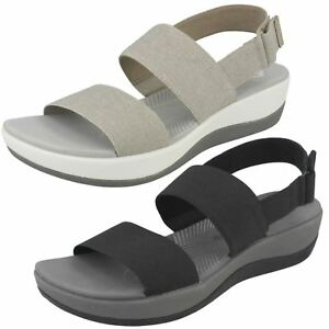 9b0594a6a533 Ladies Clarks Arla Jacory Black Or Sand Textile Sandals D Fitting