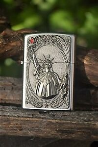 European 2.003.967 Statue of Lady Liberty Emblem Zippo Lighter Red Flame