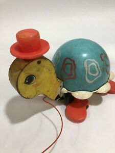 Vintage 1960s 1962 Fisher Price pull along Tip Toe Turtle colourful tortoise toy wood wooden turquoise plastic printed paper ephemera 773