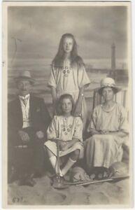 1923-Happy-Family-at-Seaside-Beach-Studio-Portrait-Real-Photo-Postcard