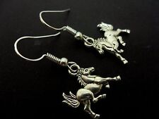 A PAIR  OF CUTE LITTLE   DANGLY   HORSE  PONY  EARRINGS.  NEW.