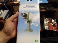 Imitation Security Camera - Battery Powered - Motion Detector & Light - <---