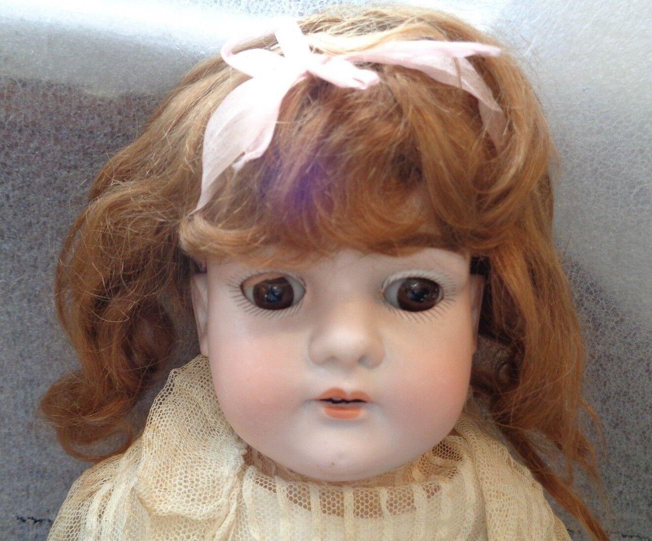Antique German bisque head girl sleeper eye doll marked L.H.B.