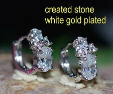 2x 0.8ct 4x6mm oval DIAM0NDS 4 stones hoops