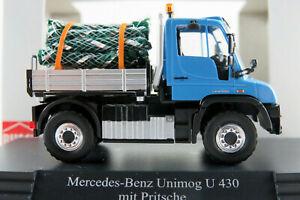 Busch-50927-Mercedes-Benz-Unimog-u-430-con-christbaumbeladung-1-87-h0-nuevo-en-el-embalaje-original