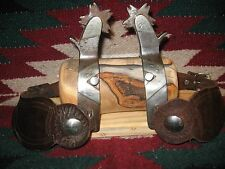 EXCEPTIONAL CROCKETT HEAVY DUTY FINE SILVER MOUNTED ROUGH STOCK SPURS & STRAPS