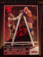 2013 Topps Best of WWE #77 WWE Champion CM Punk Defeats Ryback in TLC Match RED