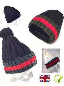 pom pom kintted beanie hat Men s Women s Bobble cap Woolly Designer ... 71903e36b52