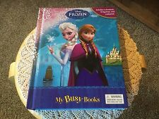 Pre Owned Disney Frozen My Busy Book.  Storybook, 12 Figurines, Playmat.