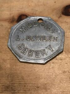 Token-Modern-Bakery-L-Catlin-Good-For-1-Loaf-Of-Bread-Octagon-Coin-C02