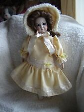 "Lilian Middleton Reproduction porcelain doll in beautiful clothing. 16"" tall"