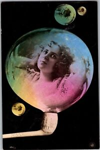 Pretty-Girl-in-a-Bubble-Pipe-Blowing-Bubbles-Rainbow-c1906-Vintage-Postcard-N20