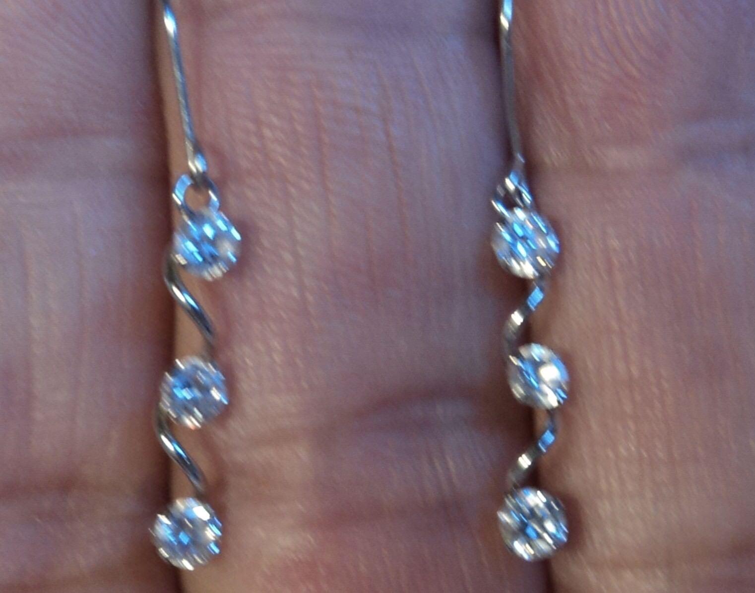 10Kt White gold Spiral Dangle Earrings Triple CZ Stones 1.2  Long .5 TCW