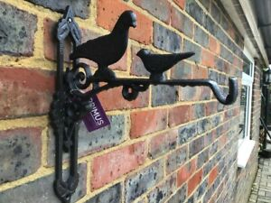 CAST IRON HANGING BRACKET DECORATED WITH BIRDS