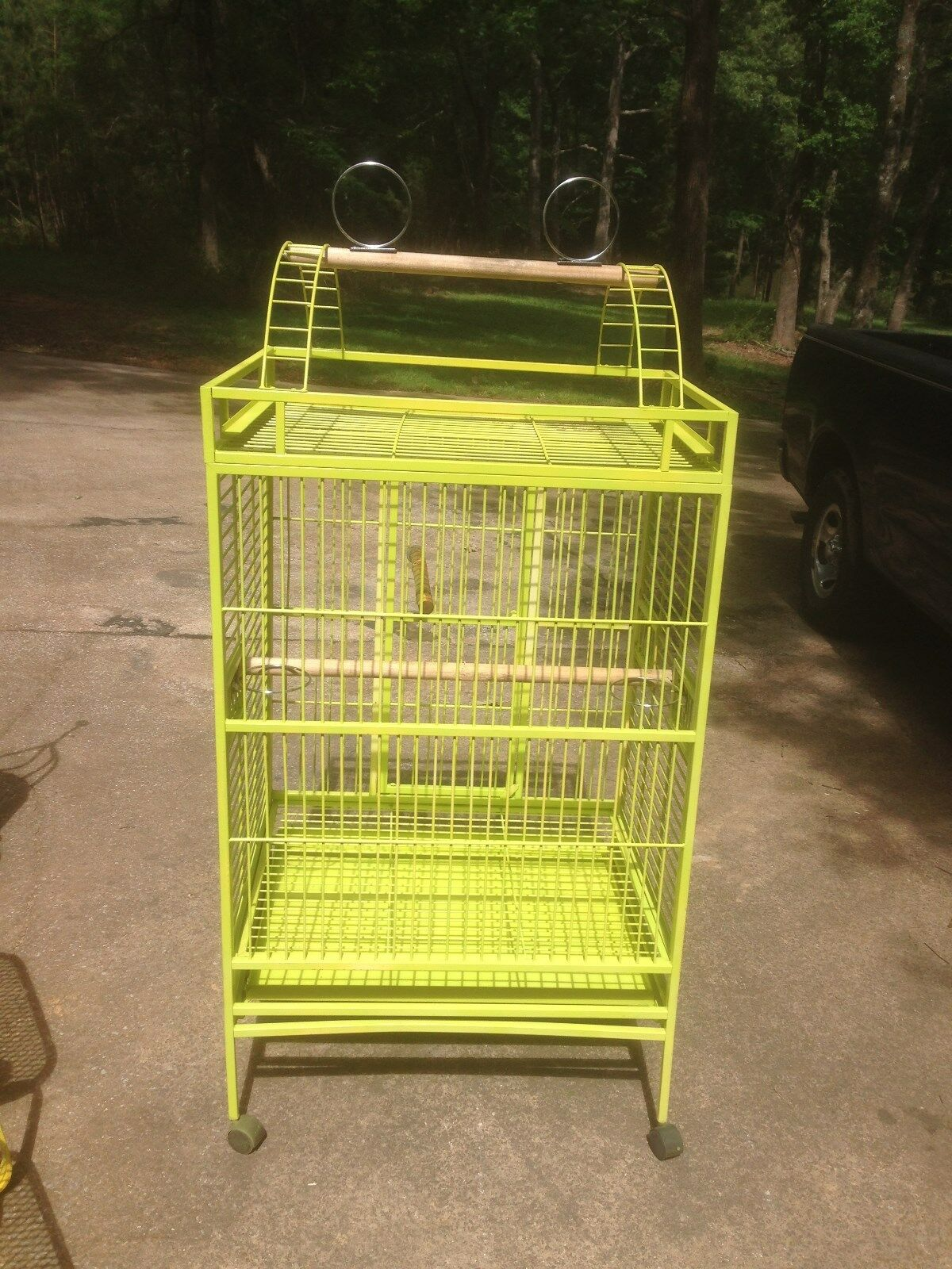 Bird cage for large birds. Bright yellow 4 tall' by 2' by 2.5'. On wheels.