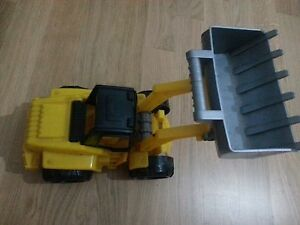 lotto-586-ruspa-trattore-giocattolo-in-plastica-cm-24