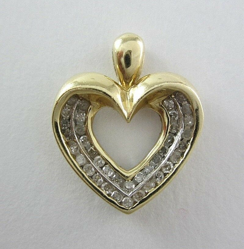 LADIES 10K YELLOW gold DIAMOND HEART PENDANT; TDW 0.25CT. 1.7G