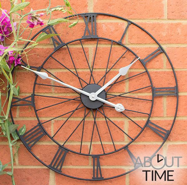 Metal Garden Wheel Wall Clock Outdoor Black Roman Numeral Skeleton Frame Battery