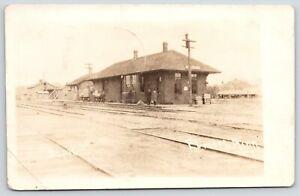 Elmore-Minnesota-Railroad-Depot-Men-Waiting-on-Platform-Stables-1914-RPPC