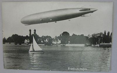 Vintage postcard German 1930 Airship Zeppelin over Friedrichshafen with stamp