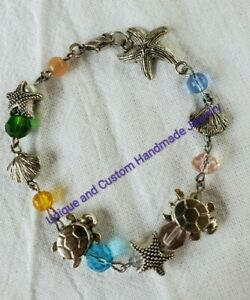 larger Multicoloured turle and star fish shell bead bracelet