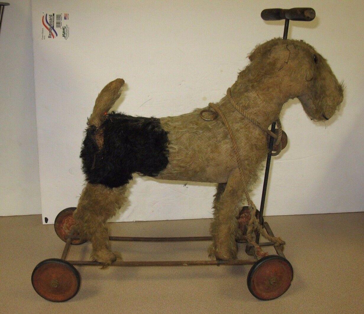 EARLY STEIFF DOG ON WHEELS STEERING TOY